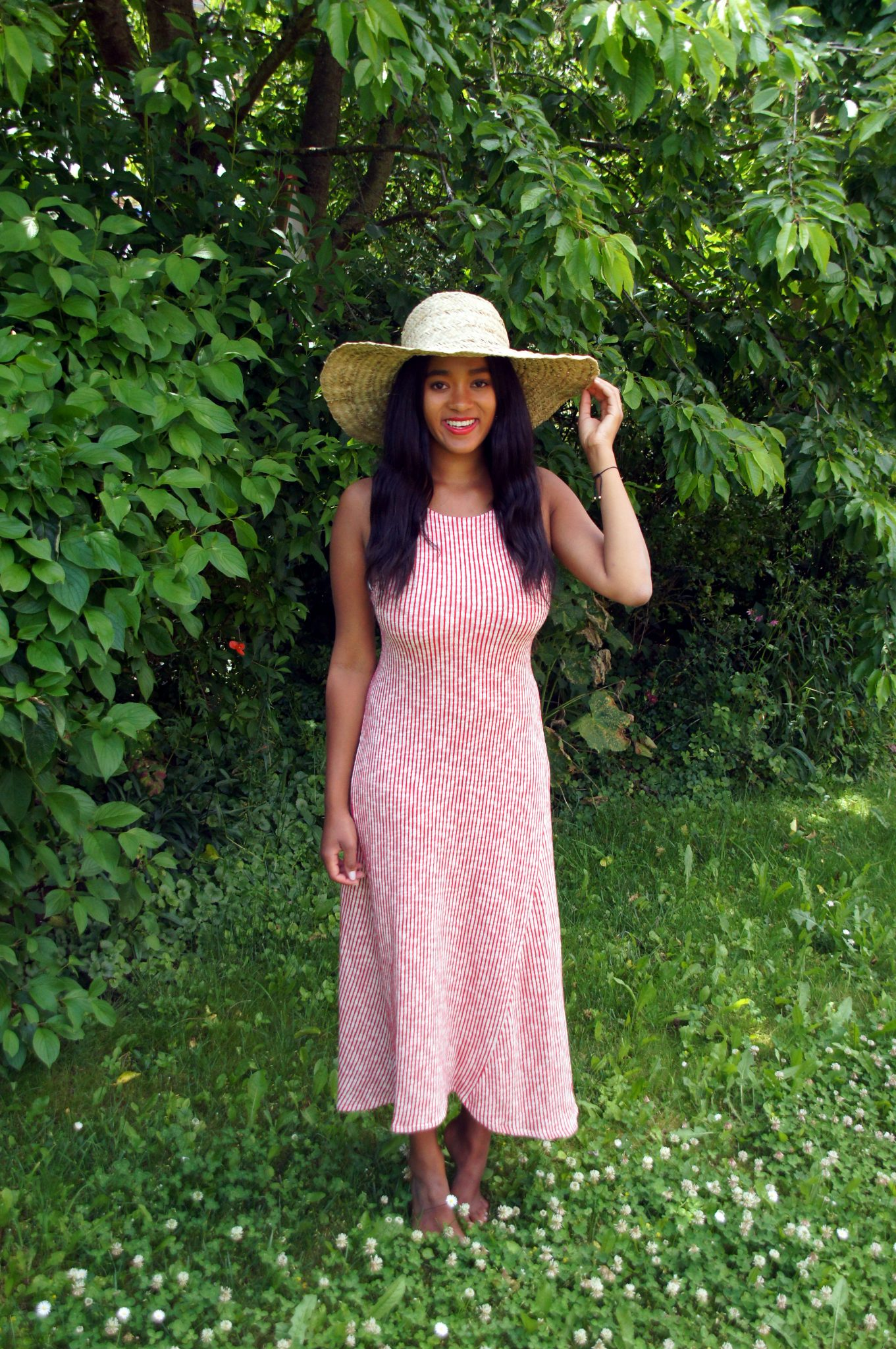 wearing a striped dress for a garden party