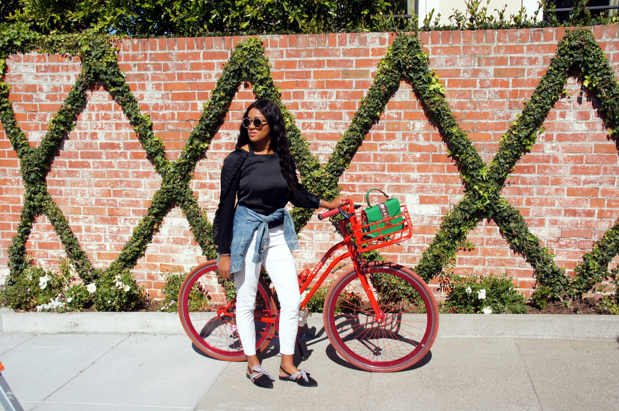 me with a red bike in front of a brick wall in San Francisco