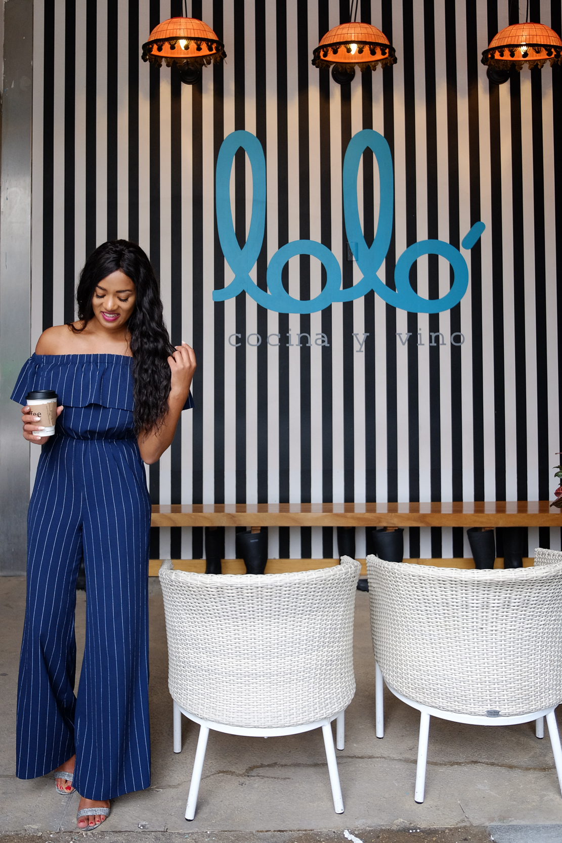 full body picture of me smiling, wearing a off shoulder pinstriped blue jumpsuit