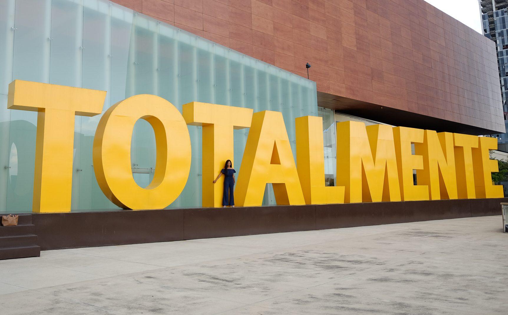 me in front of the totalmente sign in Guadalajara