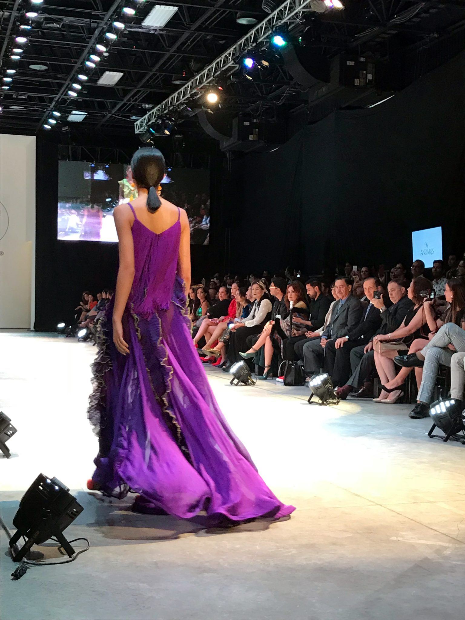 Benito Santos Models on the runway wearing redish dresses