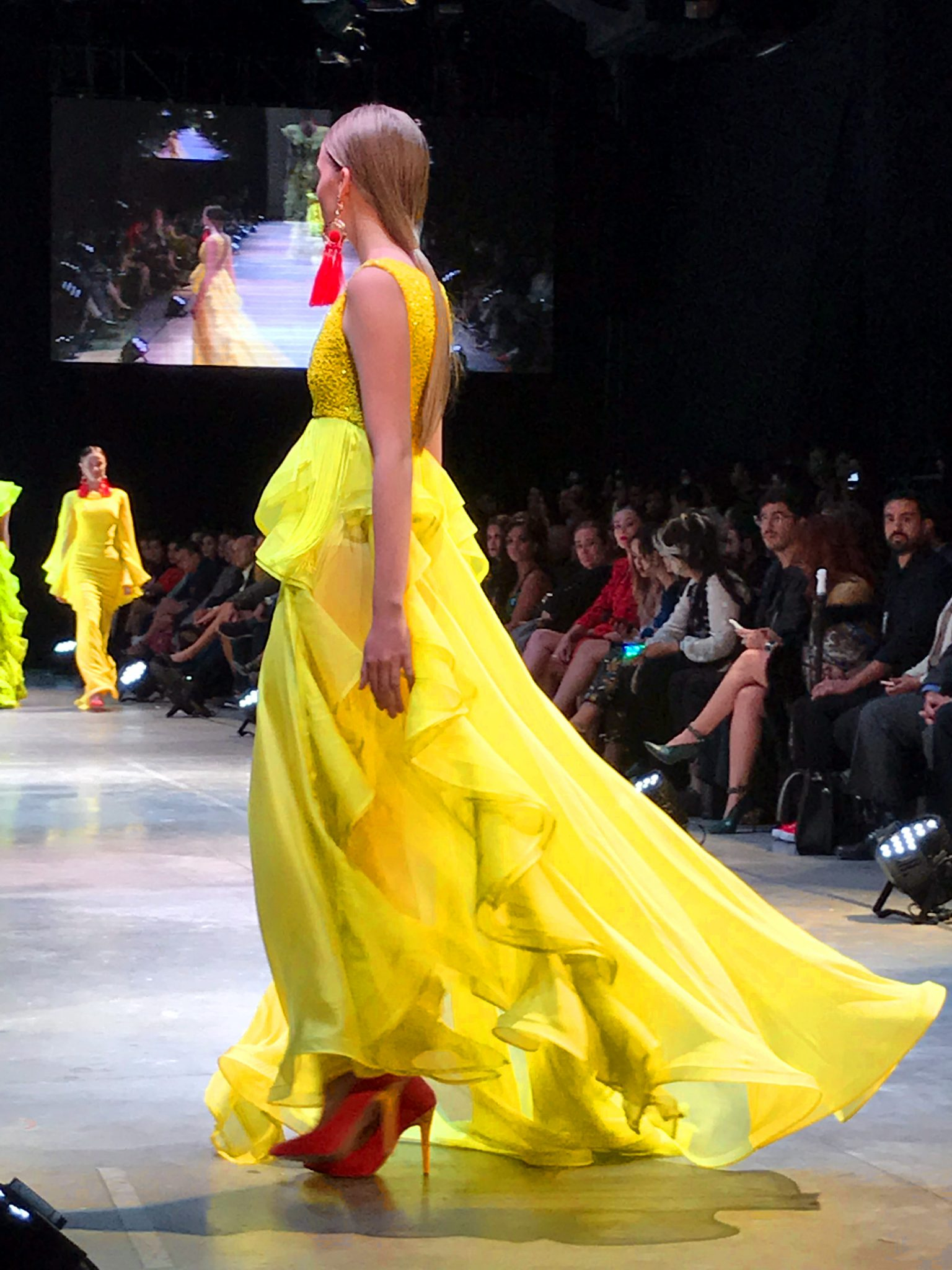 Model wearing a yellow benito santos dress