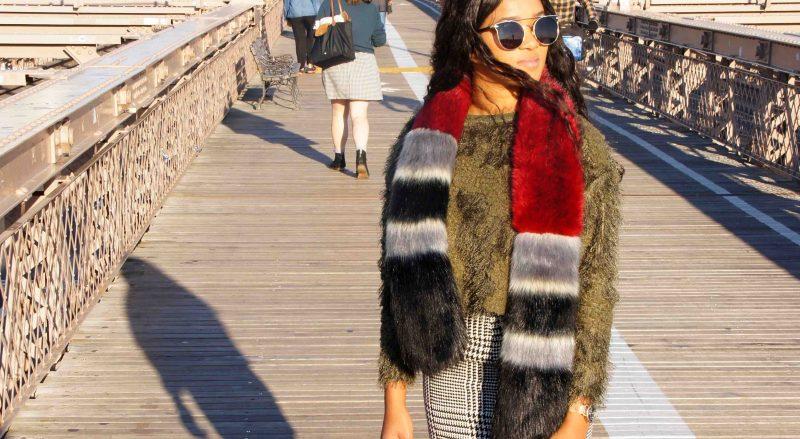 Me on wearing fake fur pieces on the Brooklyn Bridge