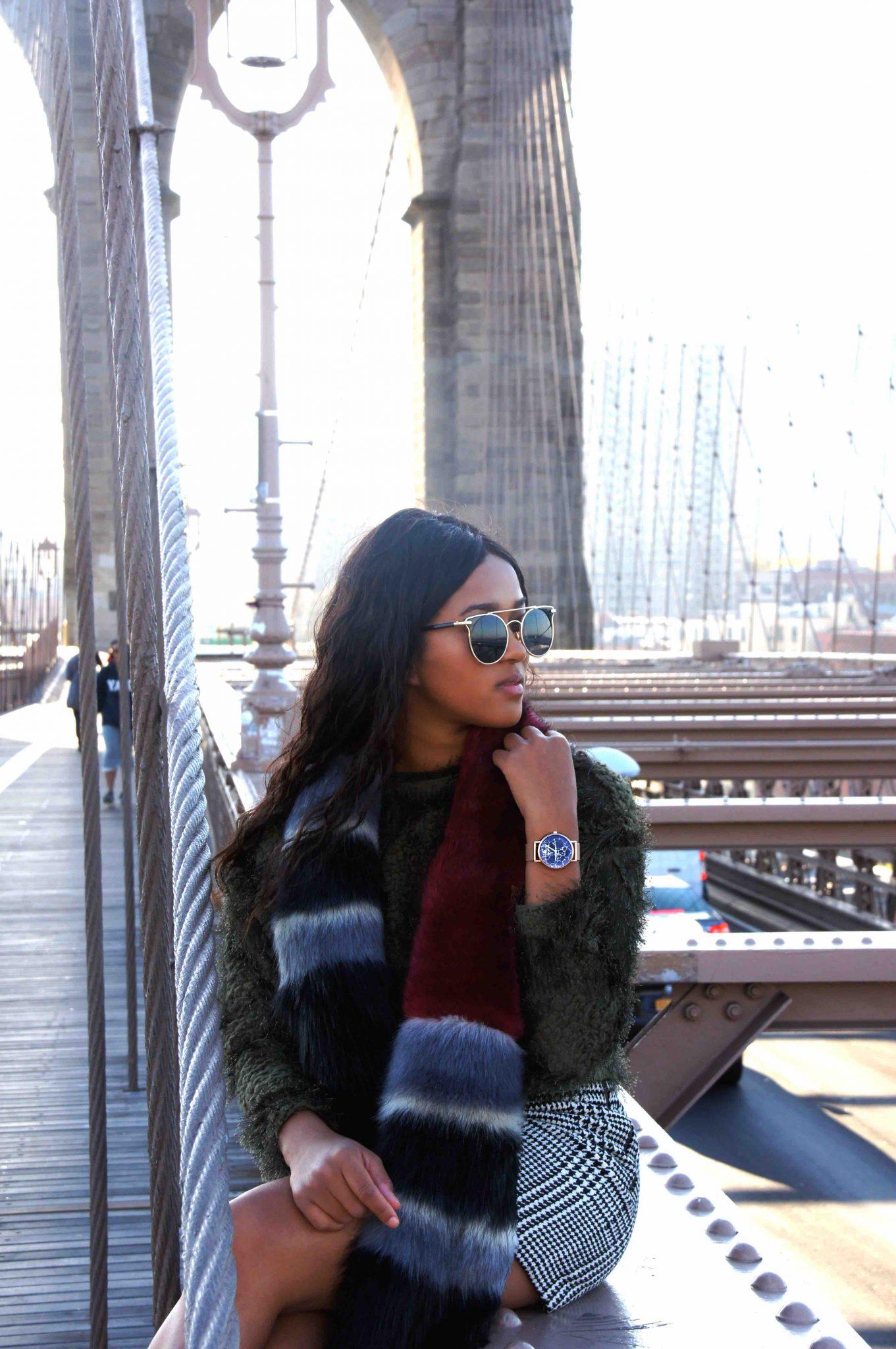 Portrait with furry scarf on brooklyn bridge