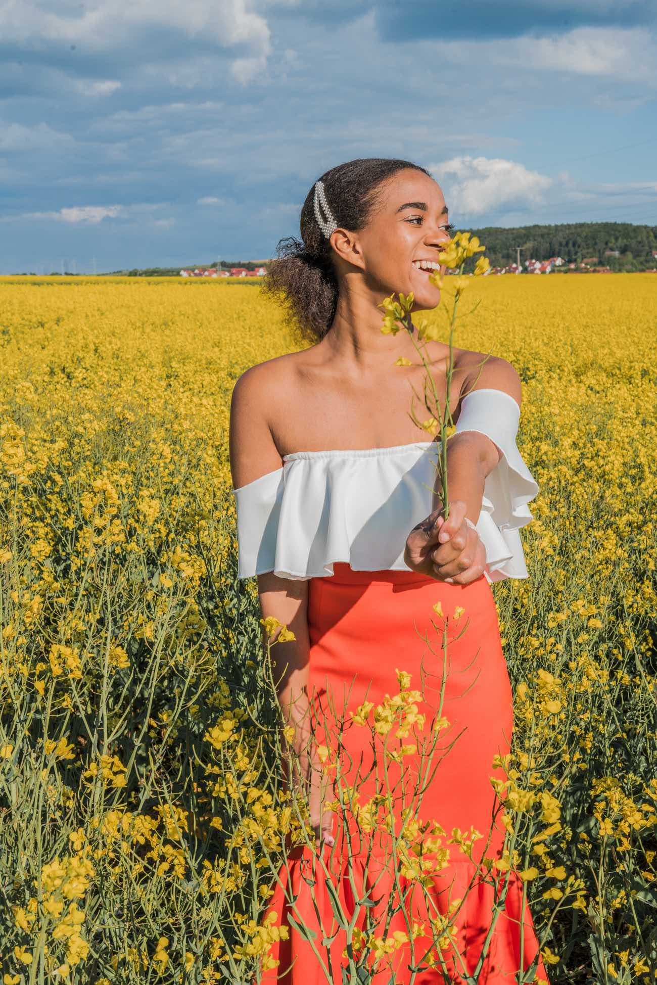 girl doing an epic summer activity in a flower field