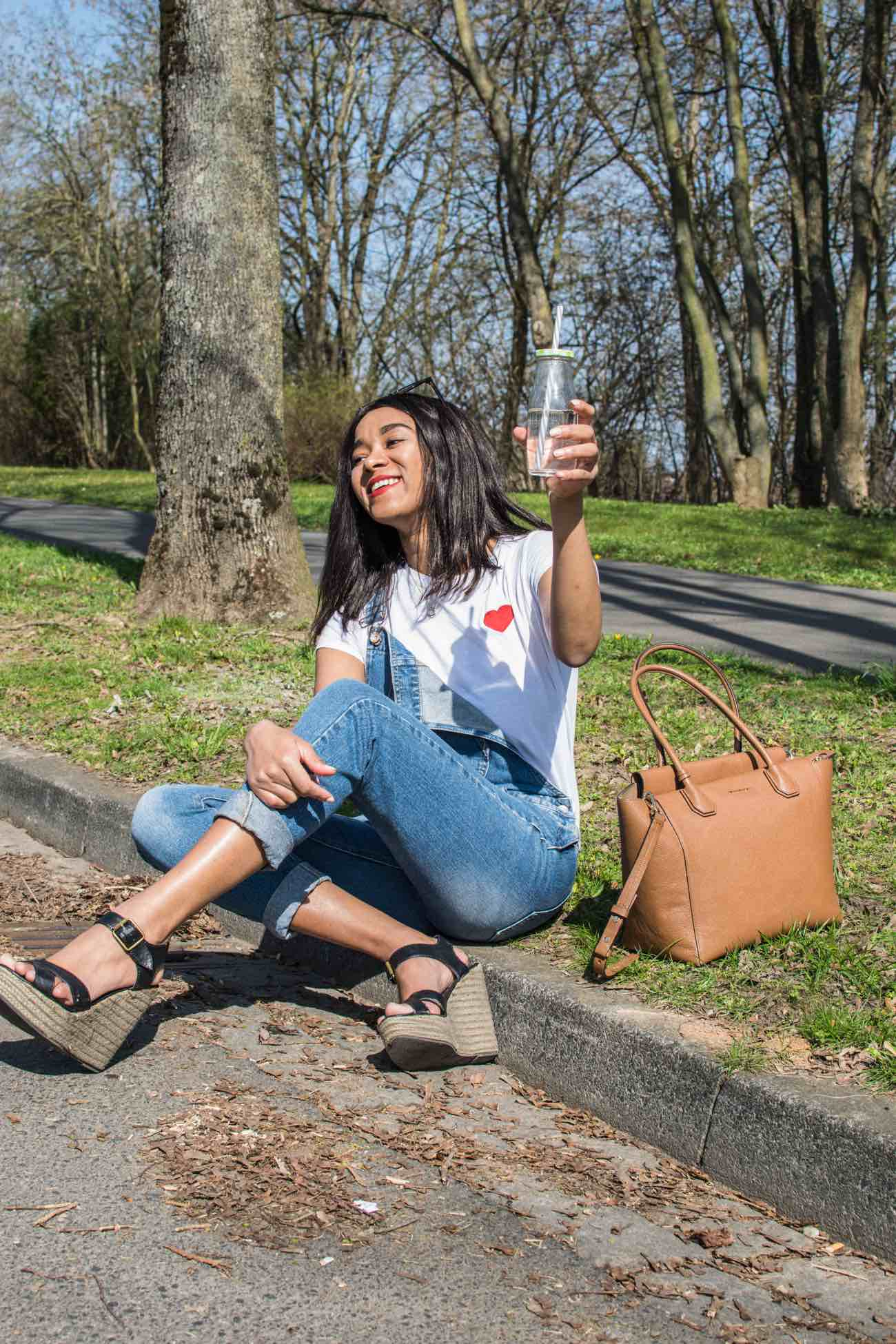 Ways to give back to the community girl in dungarees