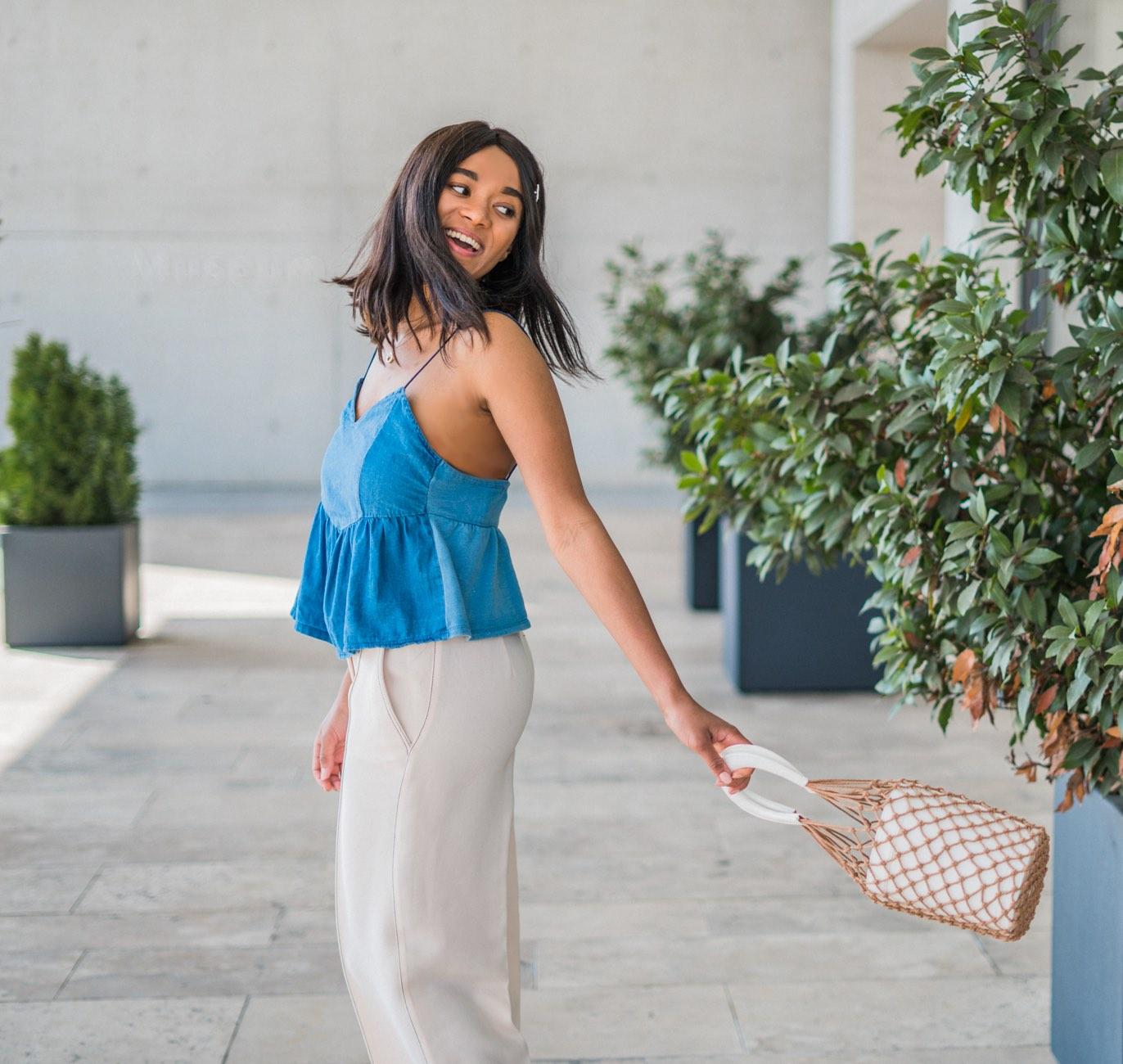 girl wearing a bucket bag, mini bag, denims