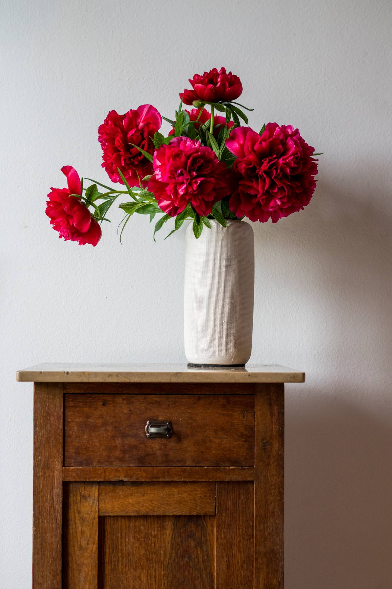 A Vase of red peonies