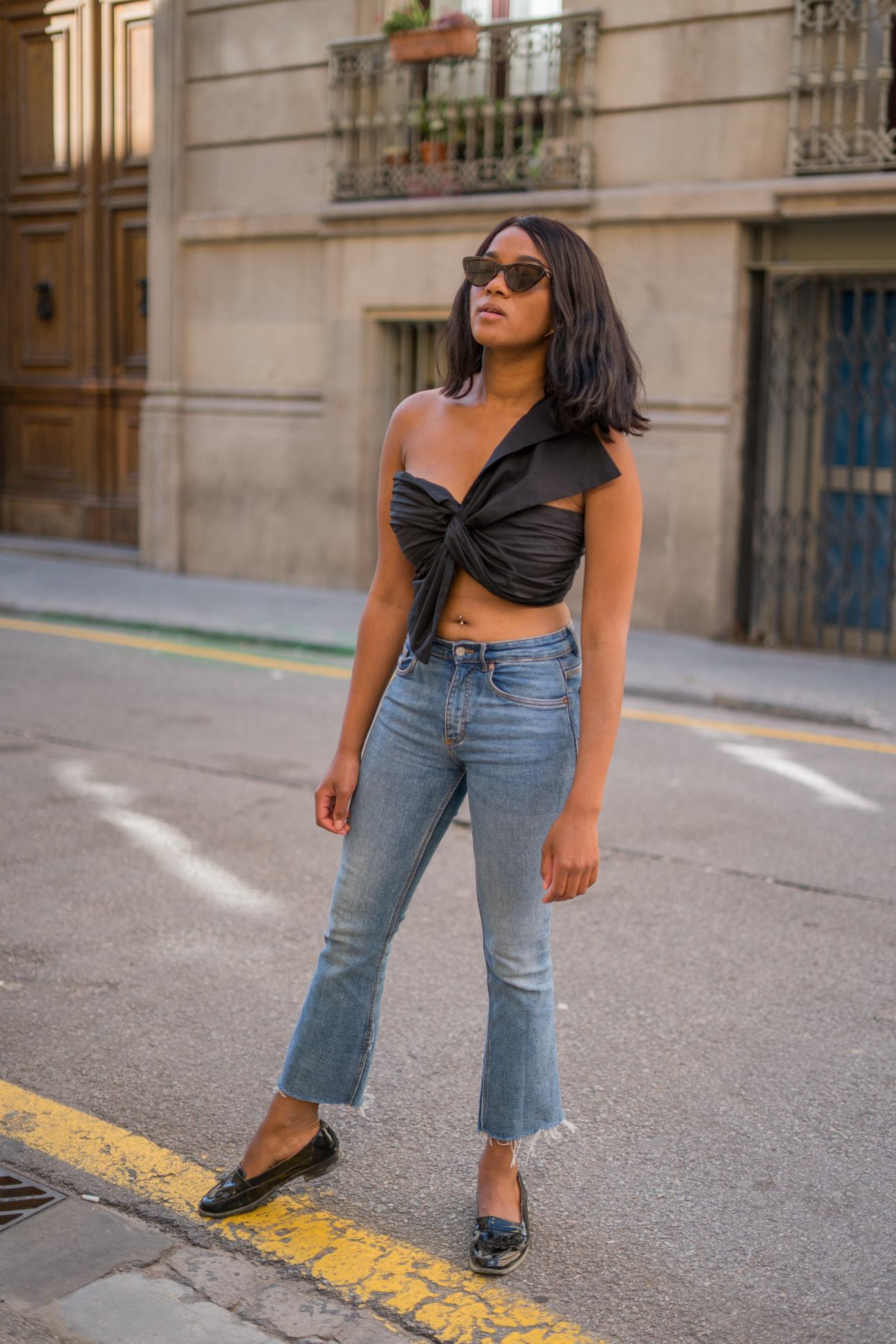 Girl wearing a blue denim and a black crop top