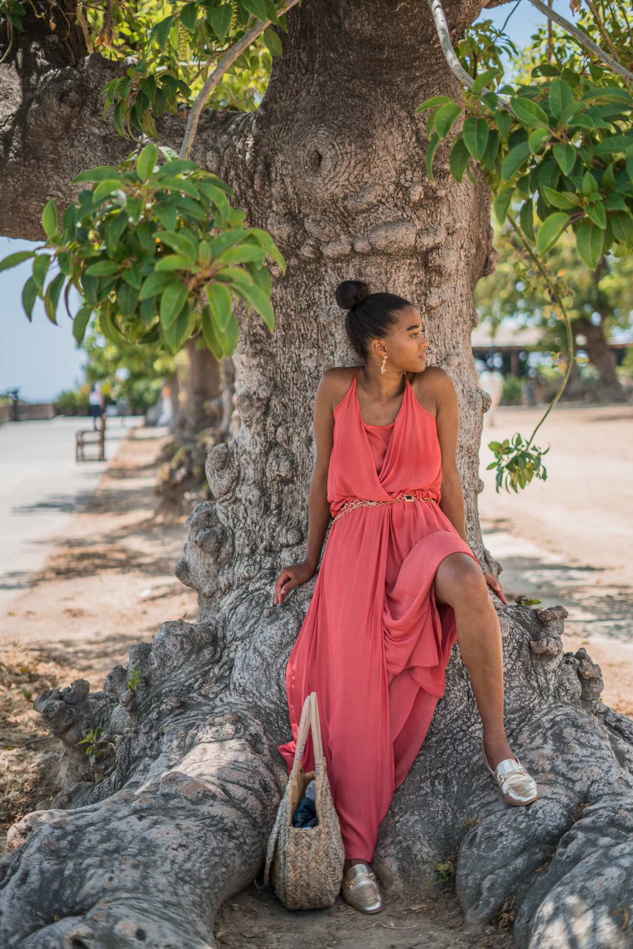 German Blogger in a orange maxi dress wearing a round straw bag