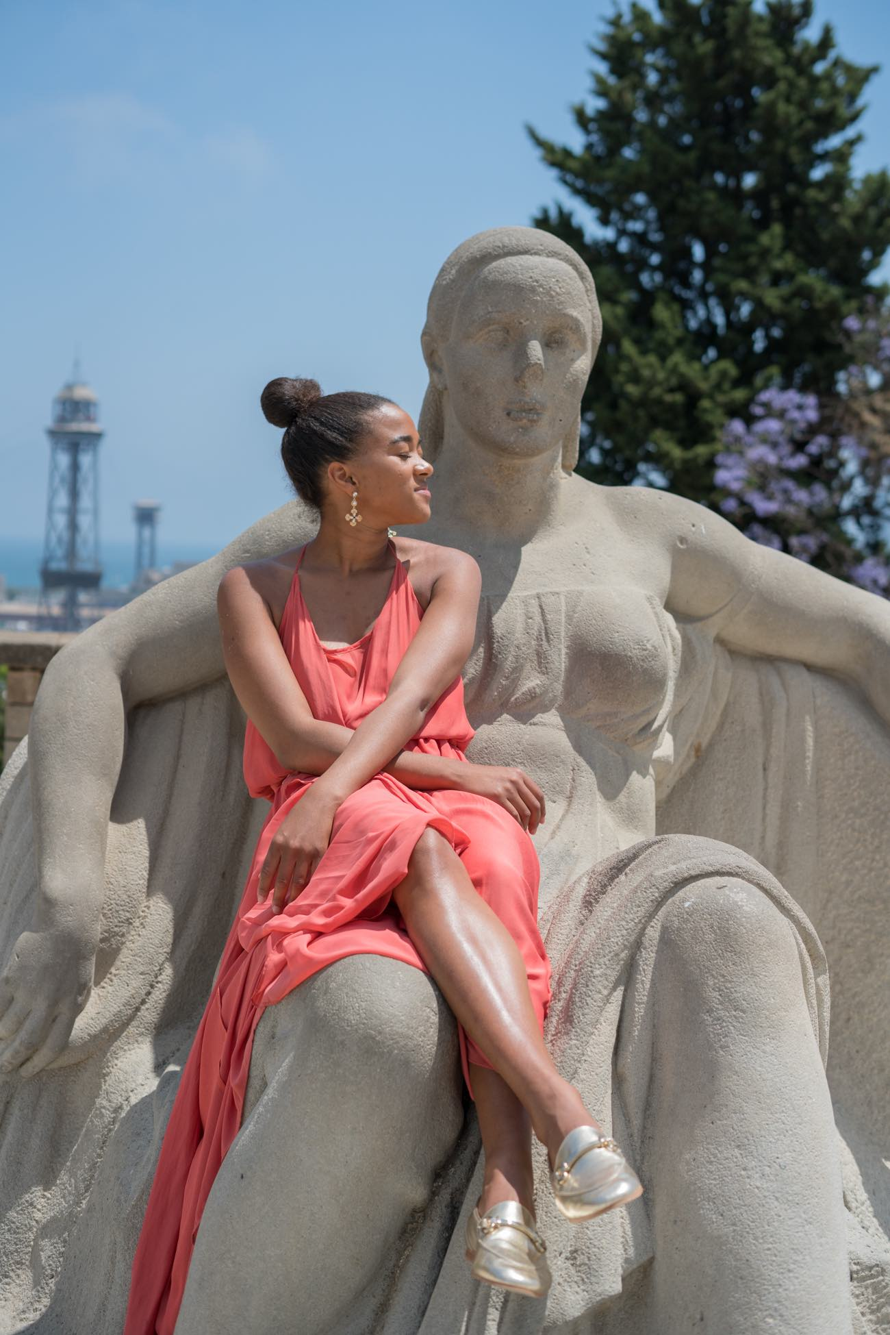 achieve your goals, goal setting, girl sitting on a statue