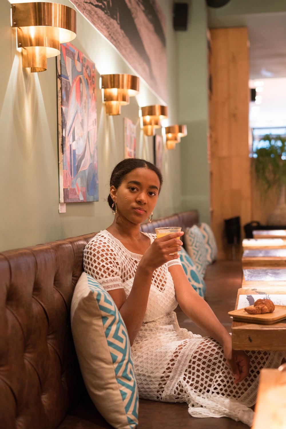 black girl wearing a white dress on a brunch date