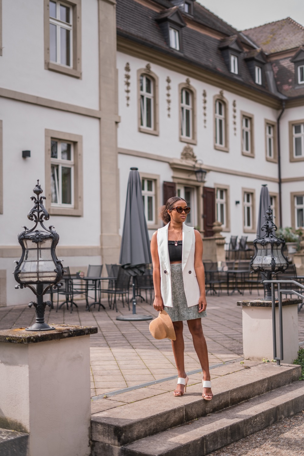 Black Fashion blogger wearing a long vest in summer
