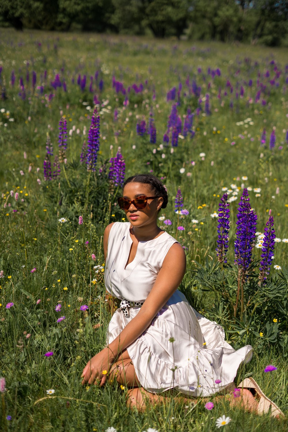 top german fashion blogger in a flower field