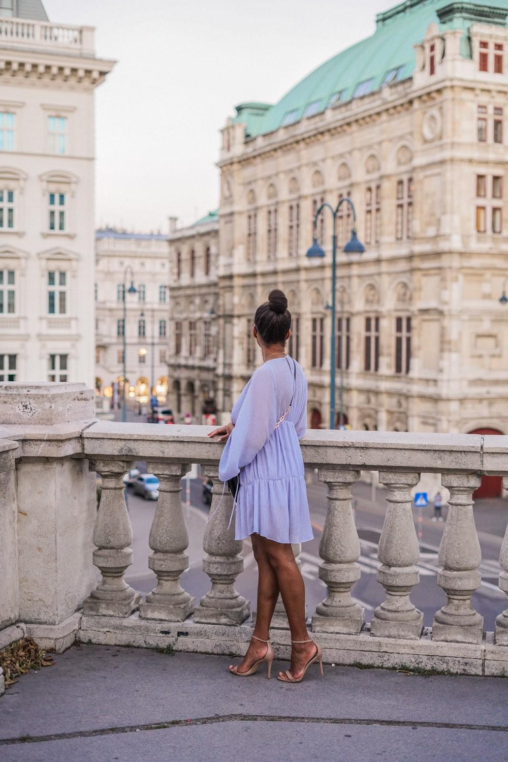 German Fashion Blogger wearing a light blue summer dress