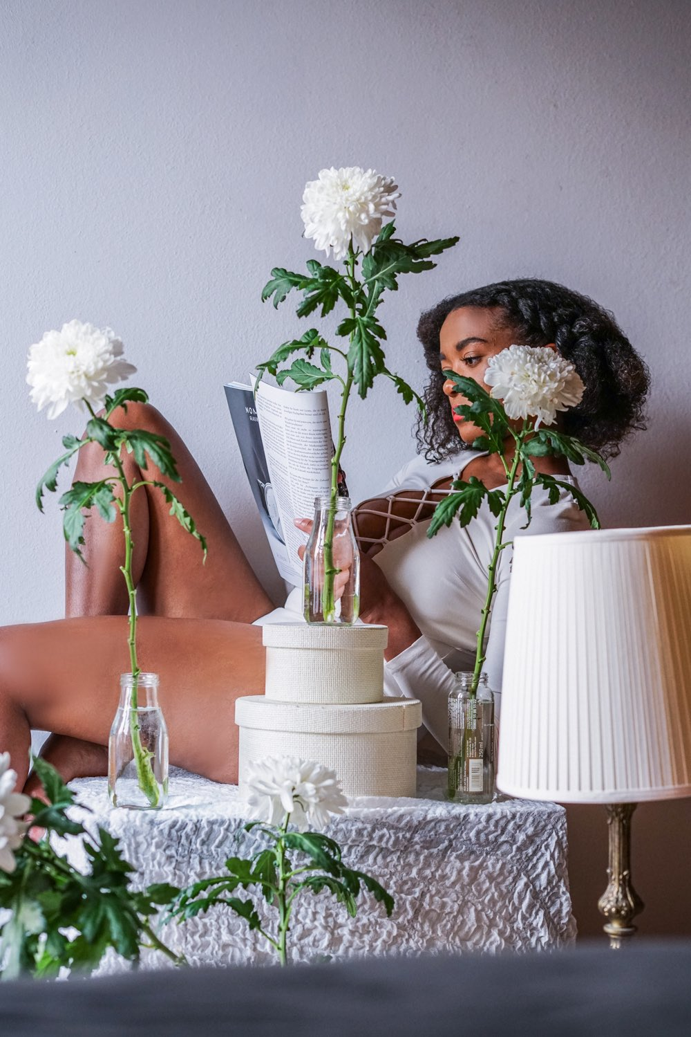 Black Fashion blogger wearing white body flower photography fashion beauty shooting