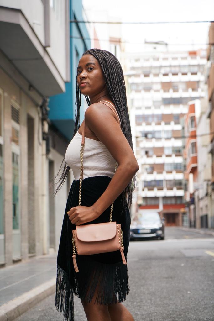 fringe skirt, white top and crossbody bag