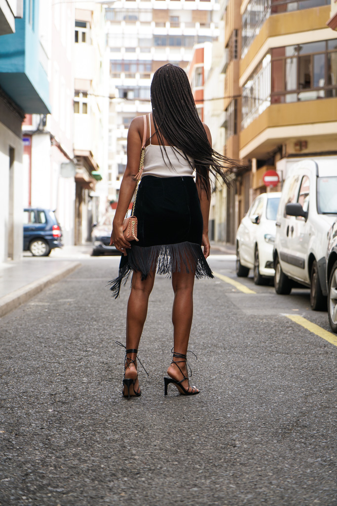 wearing fringes with crossbody bag